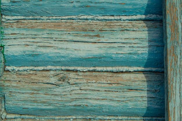 Pareti di vecchi registri, macro. vernice blu della sbucciatura di struttura della priorità bassa