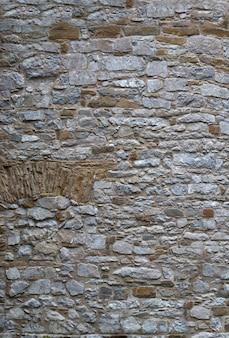 Pareti in muratura fatte di vecchie pietre di sfondo per il progettista