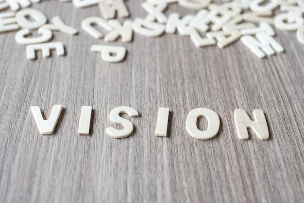 Parola di visione di lettere di alfabeto in legno. concetto di business e idea