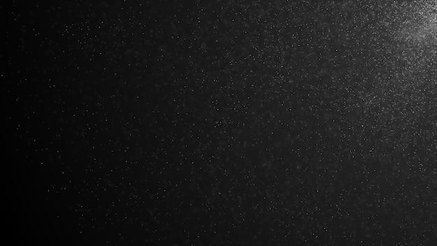 Particelle di polvere organica naturale galleggianti su uno sfondo nero