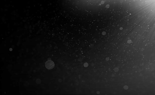 Particelle di sfondo nero e sfocatura di polvere