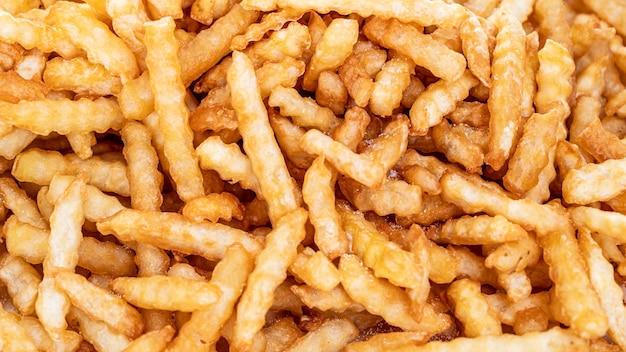 Patate fritte, patate fritte texture, concetto di cibo
