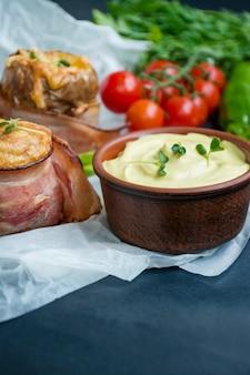 Patate novelle al forno con formaggio, pancetta