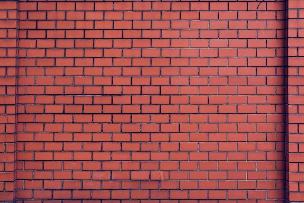 Patter di carta da parati arancione del muro di mattoni