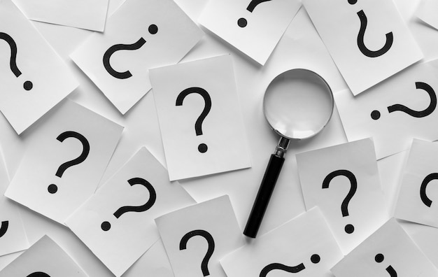 Pattern di sfondo di punti interrogativi casuali