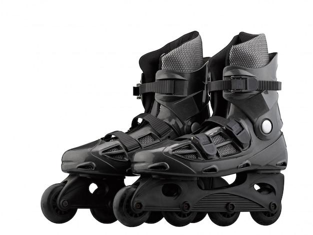 Pattini a rotelle neri e grigi isolati su bianco