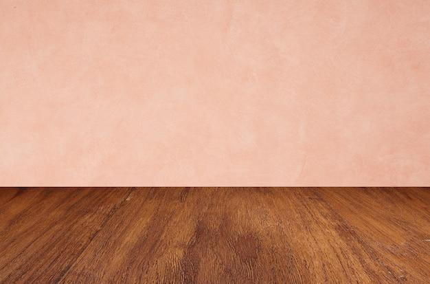 Pavimenti in legno vuoti su sfondo rosa muro