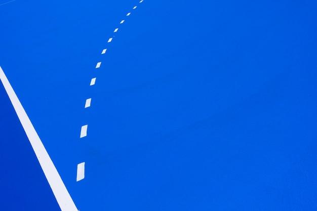 Pavimento blu di uno sfondo di campo da basket