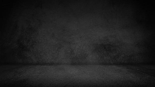 Pavimento del cemento e fondo neri della parete, oscurità