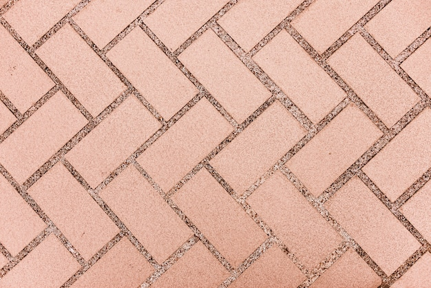 Pavimento delle mattonelle di struttura attraversato