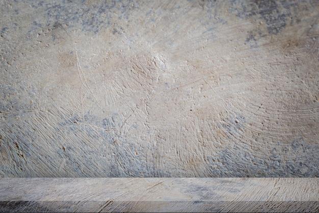 Pavimento di cemento con sfondo grigio muro di cemento grigio vuoto.