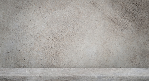 Pavimento in cemento con muro di cemento grigio vuoto.