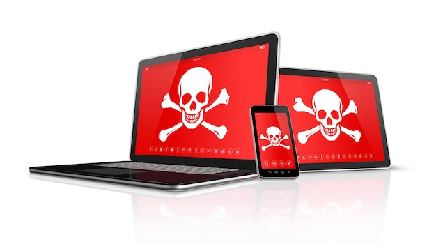 Pc e smartphone della compressa del computer portatile con i simboli del pirata sullo schermo. concetto di hacking