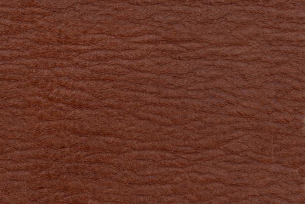 Pelle marrone. superficie della trama di colore marrone.