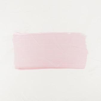Pennellata. macchia di pittura acrilica. colore rosa colpo del pennello isolato su bianco