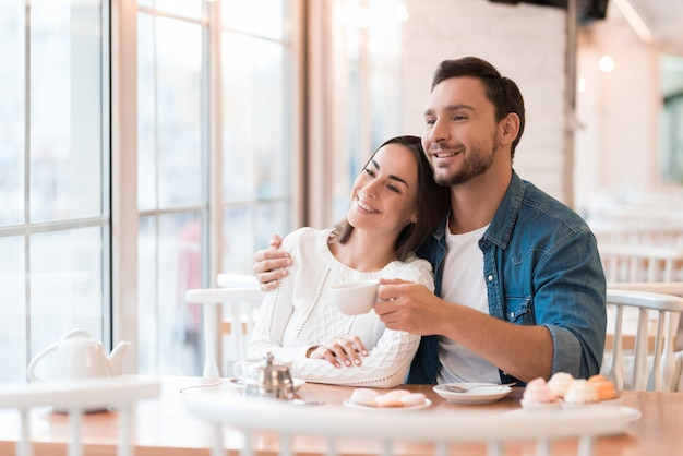 People recall sweet memories happy couple in cafe.