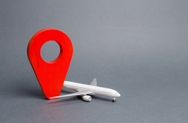 Perno di posizione rosso e aereo di linea per il passeggero. viaggi aerei e turismo, viaggi. punto di destinazione