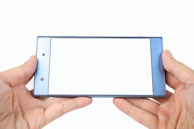 Persona che tiene smartphone in una mano, telefono in mano di una donna