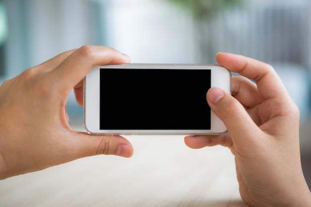 Persona di scattare una foto con il cellulare