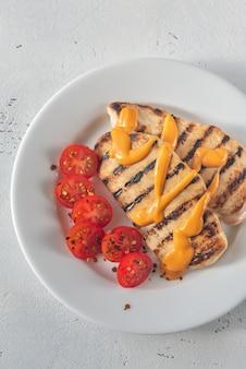 Petto di pollo grigliato con pomodorini