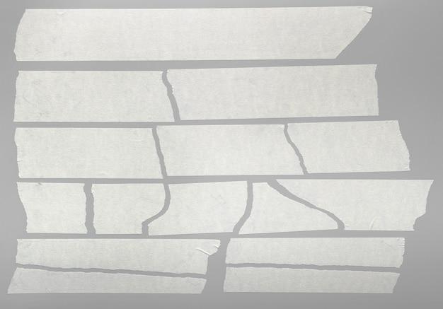 Pezzi di nastro adesivo strappati isolati