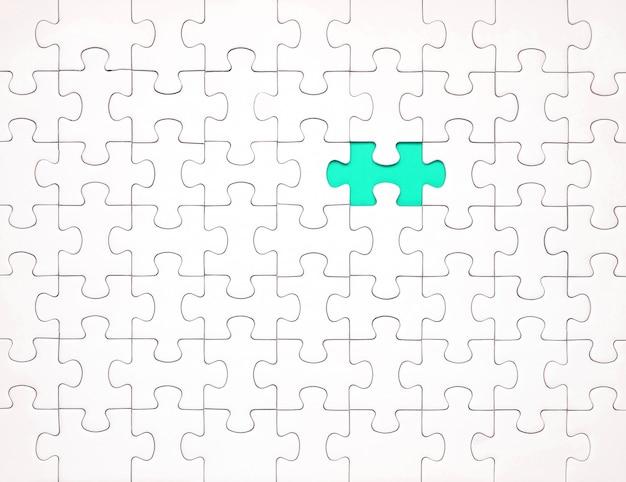 Pezzi di puzzle bianchi su sfondo blu. sfondo per il contenuto
