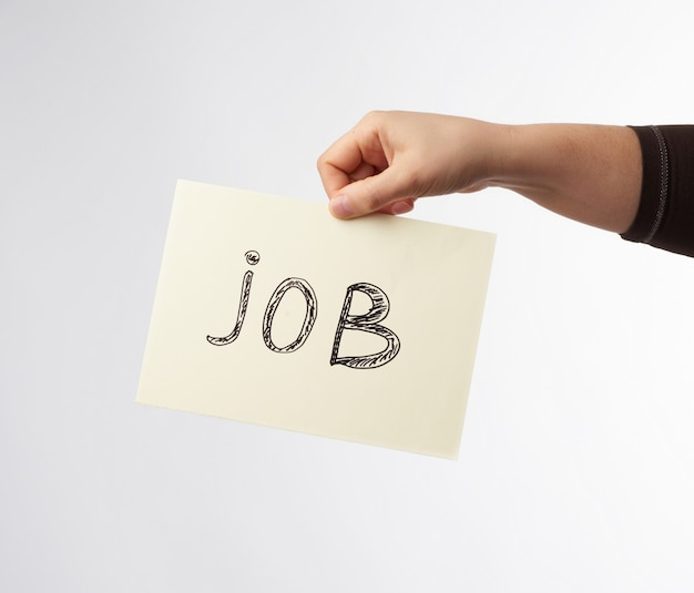 Pezzo di carta con il lavoro di iscrizione, concetto di disoccupazione