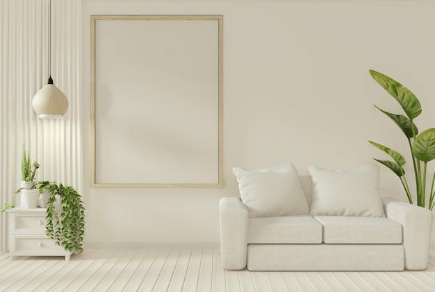 Piante divano e decorazione in soggiorno con parete bianca.