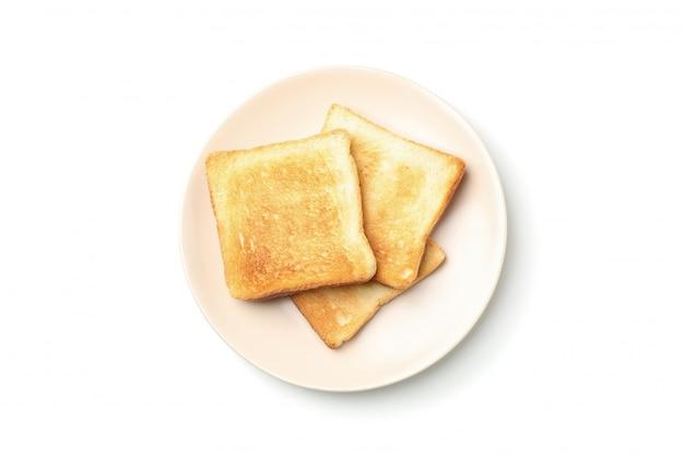 Piastra con gustosi toast isolati su sfondo bianco, vista dall'alto
