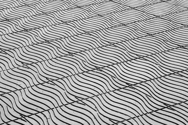 Piastrelle per pavimento nel fondo urbano della via della città - monocromatico