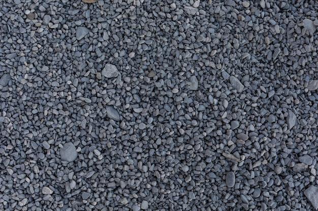 Piccole pietre grigie per la costruzione a terra