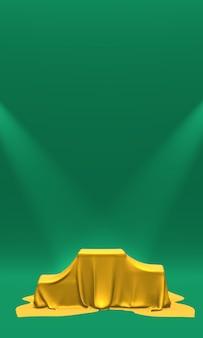 Piedistallo coperto con un panno verde illuminato da faretti