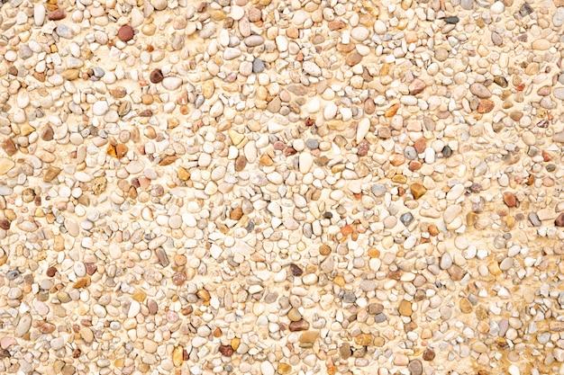Pietra beige finitura texture di sfondo. muro di architettura