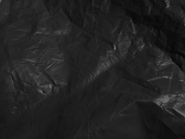 Pietra nera astratta scura e grigia sullo sfondo della trama