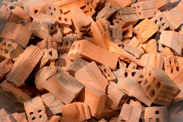 Pila di mattoni grezzi texture, pila di mattoni arancione per la costruzione.