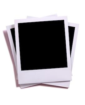 Pila disordinata di foto in stile polaroid