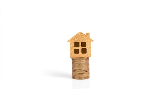 Pila finanziaria della moneta di conceptmoney di ipoteca della casa e di investimento immobiliare