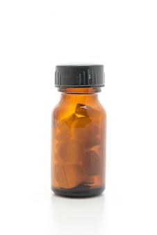 Pillole, droghe, farmacia, medicina o medica delle compresse su fondo bianco
