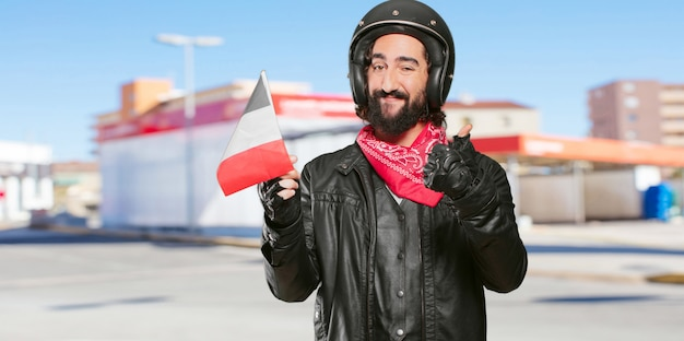 Pilota di moto con una bandiera della francia