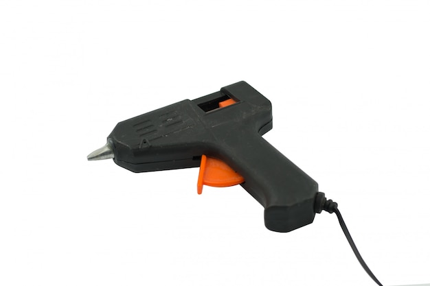 Pistola per colla isolata su bianco