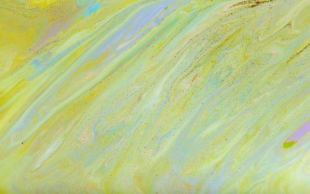 Pittura astratta verde con glitter dorati. sfondo liquido astratto
