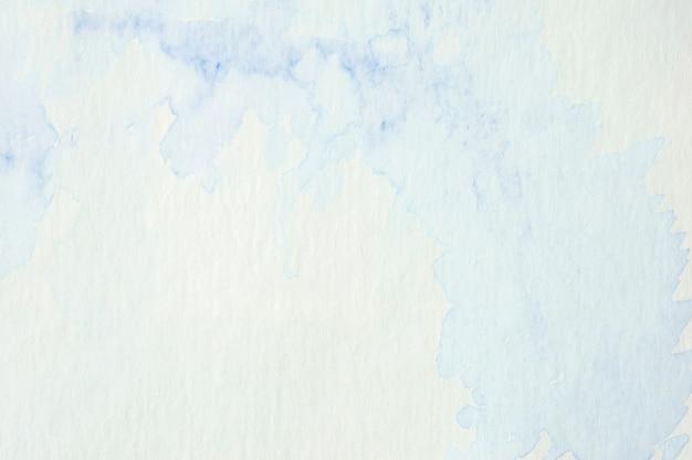 Pittura blu dell'acquerello del bstract strutturata sul fondo del libro bianco