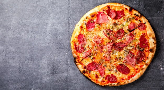 Pizza peperoni salame bacon and hamon