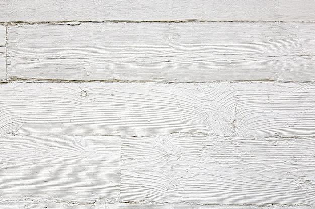Plance di legno bianche uno sfondo