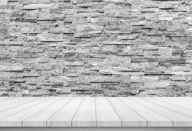Plancia di legno con sfondo astratto muro di mattoni in pietra per la visualizzazione del prodotto