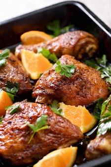Pollo fritto con arance