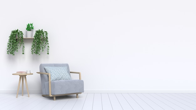 Poltrona soggiorno e piante ornamentali con a sul pavimento adiacente al muro