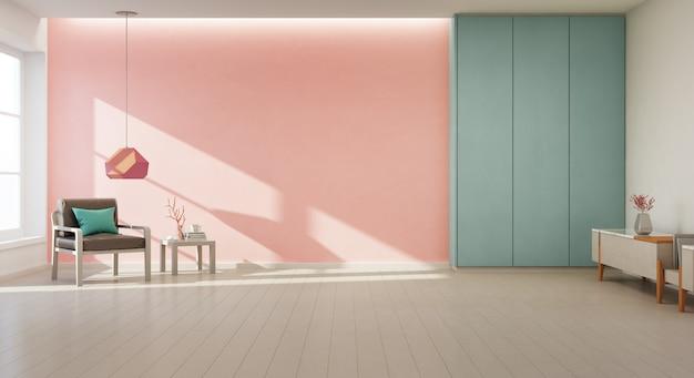 Poltrona sul pavimento di legno con finestra e muro di cemento corallo in ampio soggiorno nella moderna casa nuova.