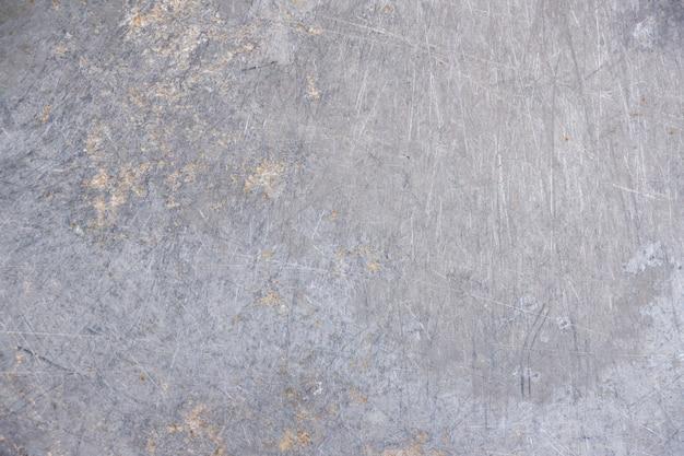 Polvere di lerciume e struttura graffiata del fondo del metallo