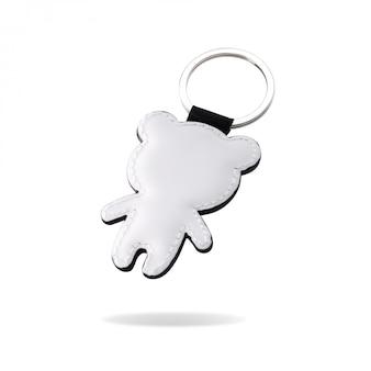Portachiavi a anello in pelle a forma di orso su sfondo bianco isolato.